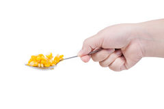 Sweet corn in spoon ready for eat with hand Stock Photo