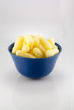 Sweet corn sticks in the blue bowl. The photo shows the sweet corn sticks in the blue bowl on white background Stock Photo