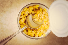 Sweet corn in a tin. Sweet corn in an open tin can with a spoon. Top view Stock Photo
