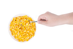 Sweet corn in white bowl ready for eat with hand and spoon Stock Photo