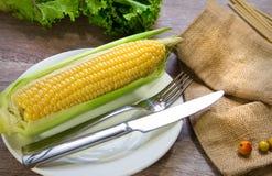 Sweet corn on wood. Background Royalty Free Stock Photos