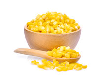 Sweet corn in wooden bowl and spoon isolated on white Royalty Free Stock Image