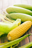 Sweet corn on wooden table Stock Image