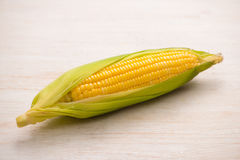 Sweet corns. Fresh corn on cobs on wooden table. Stock Photography