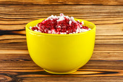 Sweet cottage cheese dessert with raspberry jam in ceramic bowl on wooden table Royalty Free Stock Photo