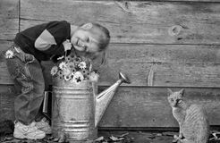 little girl with cat and flower Royalty Free Stock Image