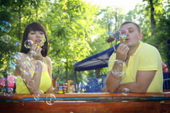 Sweet Couple Blowing Bubbles Outdoor Stock Photo