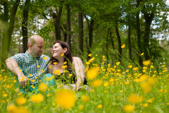 Sweet couple and buttercups Royalty Free Stock Photo
