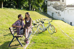 Sweet couple drinking coffee in park Stock Photo