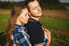 Sweet couple embrace passionately in nature Royalty Free Stock Image