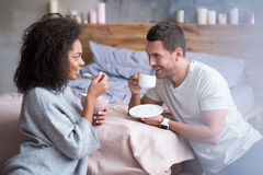 Sweet couple enjoying their breakfast together Stock Images