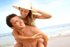 Sweet couple having fun at the beach Stock Photography