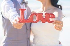 Sweet couple holding Stock Images