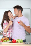 Sweet couple in home kitchen Royalty Free Stock Images