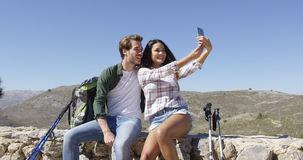 Sweet couple making selfie Stock Images