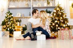Sweet couple opening Christmas gifts royalty free stock images