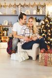 Sweet couple opening Christmas gifts royalty free stock photo