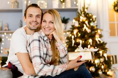 Sweet couple opening Christmas gifts royalty free stock photos