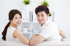 sweet couple sitting in sofa Stock Image