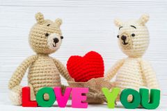 Sweet couple teddy bear doll in love with Love text and red knit royalty free stock photo