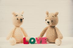 Sweet couple teddy bear doll in love with Love text and red knit stock photography