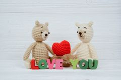 Sweet couple teddy bear doll in love with Love text and red knit royalty free stock image