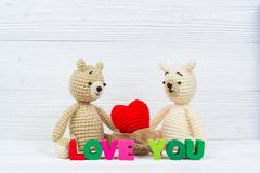 Sweet couple teddy bear doll in love with Love text and red knit royalty free stock photos