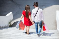 Sweet couple walking holding hands Stock Images