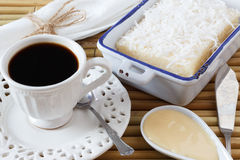 Sweet couscous pudding , coconut, cup of coffee, condensed milk Royalty Free Stock Image
