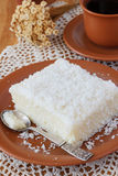 Sweet couscous (tapioca) pudding (cuscuz doce) with coconut Royalty Free Stock Images
