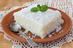 Sweet couscous (tapioca) pudding (cuscuz doce) with coconut. Brazilian traditional dessert: sweet couscous (tapioca) pudding (cuscuz doce) with coconut on plate Stock Images
