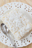 Sweet couscous (tapioca) pudding (cuscuz doce) with coconut Royalty Free Stock Photography