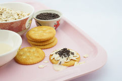 Sweet cracker on pink plate. Cracker, oat, chocolate and  sweetened condensed milk placed on a pink plate Stock Image