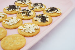 Sweet crackers on pink plate. Crackers with oat, chocolate and  sweetened condensed milk placed on pink plate Stock Photography