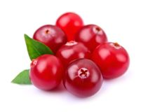 Sweet cranberries with leafs Stock Photos