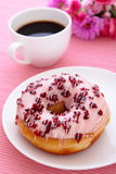 Sweet cranberry donut with a cup of coffee Royalty Free Stock Photography