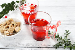 Sweet cranberry tea on the boards Stock Images