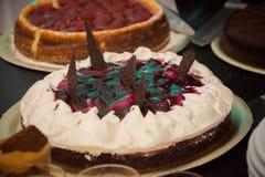Sweet cream cakes with chocolate stock image