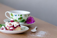 Sweet berry cake with cup of tea on wooden table Royalty Free Stock Photo