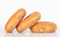 Sweet creamy soft brown donuts  Royalty Free Stock Images