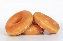 Sweet creamy soft brown donuts Stock Photography