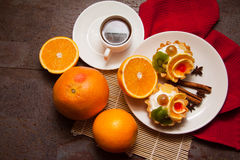 Sweet creamy tartlets and morning coffee Stock Image