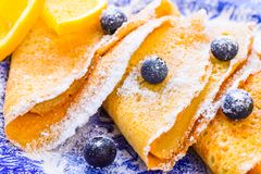 Sweet crepes with berries breakfast plate. Stock Images