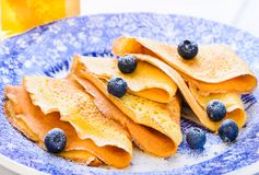 Sweet crepes with berries delicious breakfast plate. Stock Image