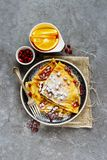 Sweet crepes with pomegranate. Flat lay of crepes in plate topped with pomegranate and sugar. Homemade thin pancakes and fruits royalty free stock image