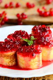 Sweet crepes rolls with redcurrant confiture on a white plate. Little stuffed crepes dessert recipe. Delicious Easter brunch idea. Sweet pancakes. Sweet stuffed Stock Photography