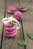 Sweet crimson french macaroons wiht hyacinth flowers and mint on dark wooden background Stock Image