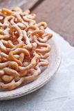 Sweet crisp pastry deep fried and sprinkled with powdered sugar Royalty Free Stock Image