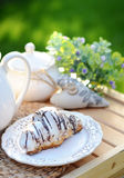 Sweet croissant with a cup of coffee. Sweet, warm croissant with a cup of coffee Royalty Free Stock Images