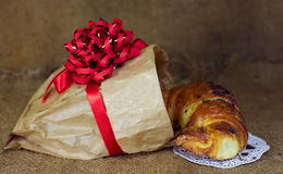 Sweet croissants with chocolate Christmas present Stock Image